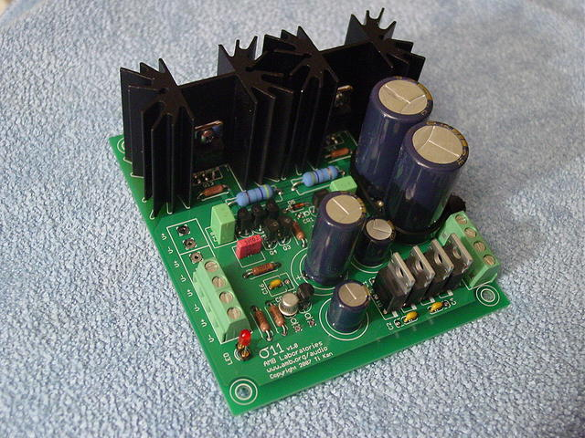 The σ11 regulated power supply